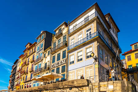 Porto Ribeira Square Breathtaking Picturesque View of Residential Buildings and Restaurants on a Sunny Blue Sky Day in Winter