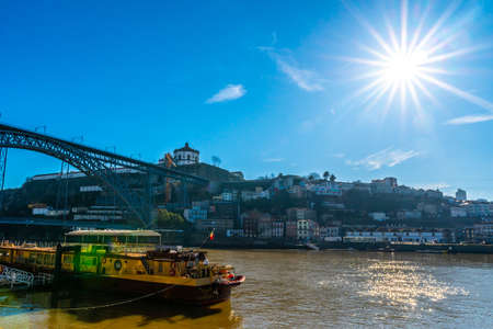 Porto Douro River Picturesque View of a Ship with Sun Rays on a Sunny Blue Sky Day in Winter