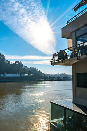 Porto Picturesque View of Casa d'Oro Restaurant with Vila Nova de Gaia District View on a Sunny Blue Sky Day in Winter Editorial