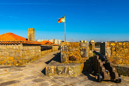 Porto Fort of Saint Francis Xavier Picturesque View with Waving Portuguese Flag and Cannon Guns on a Sunny Blue Sky Day