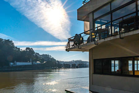 Porto Picturesque View of Casa d'Oro Restaurant with Vila Nova de Gaia on a Sunny Blue Sky Day in Winter