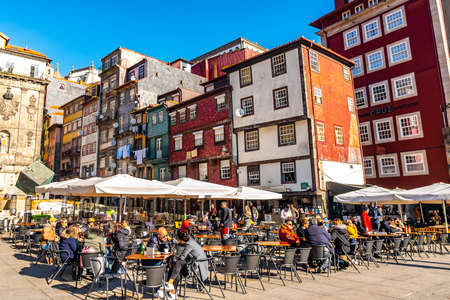 Porto Ribeira Square Breathtaking Picturesque View of People at Restaurants and Cafes on a Sunny Blue Sky Day in Winter Editöryel