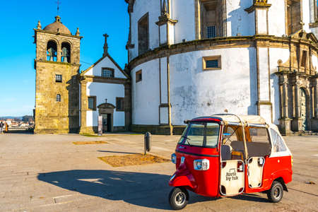 Porto Claustros do Mosteiro da Serra do Pilar Monastery Breathtaking Picturesque View of a Parked Rickshaw Taxi on a Blue Sky Day in Winter