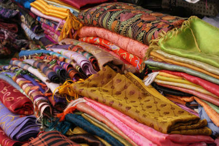 A collection of brightly coloured silk garments photo