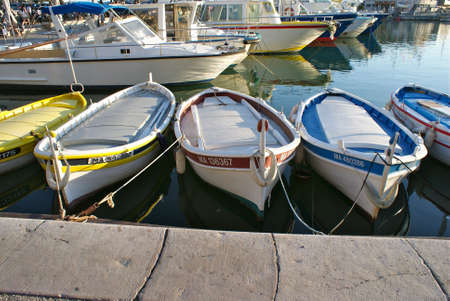 Small row boats on port side at sunset