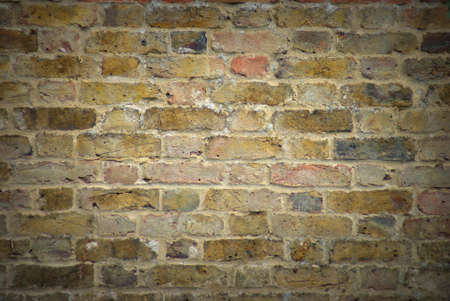 Old, vignette style Brick Wall Texture Background photo
