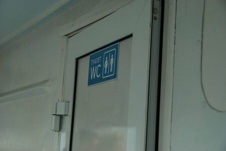 Restroom sign on a toilet door,on the river ship