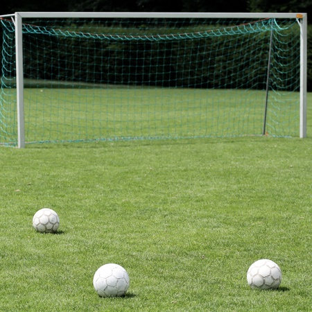 soccer balls in front of goal   photo