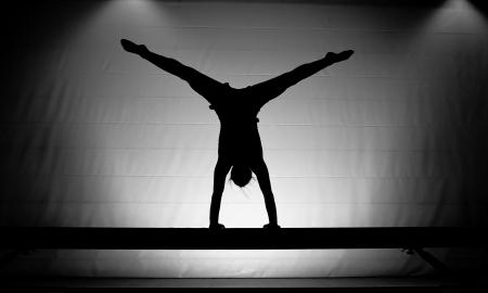 balance beam: silhouette of gymnast on balance beam