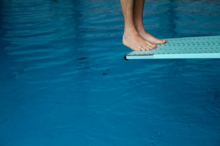 free diving: feet on diving board Stock Photo