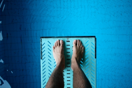 free dive: feet on diving board Stock Photo
