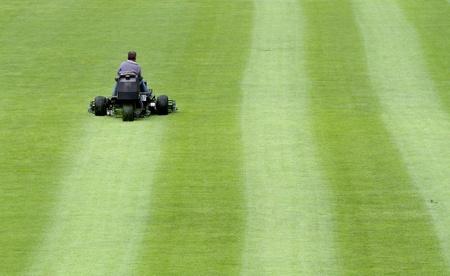 mowing grass: mowing soccer stadium Stock Photo