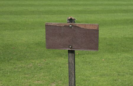 empty wooden sign on field photo