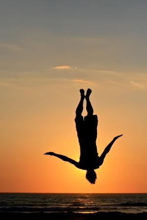 backflip: sunset jump on beach in sunset