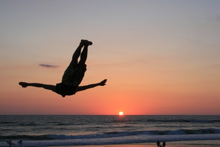 sunset jump on beach in sunset photo