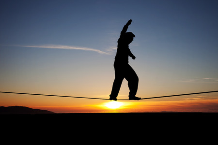 silhouette of slackliner in sunset Stok Fotoğraf