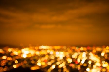夜には黄金都市ボケ ライト 写真素材