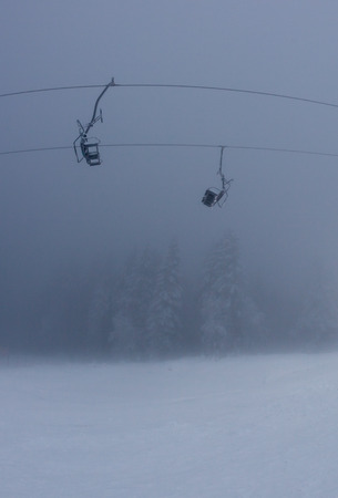 ski lift: ski lift in fog