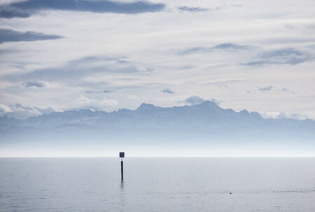 view from lake constance into swiss alps