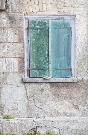 old green window shutters photo