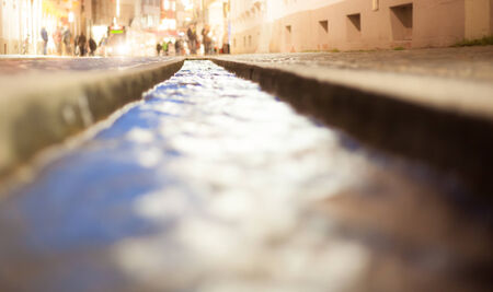urbanized: small canal in freiburg at night