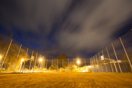 fencing wire: soccer court cage at night