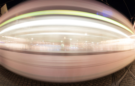 freiburg: blurred tram in Freiburg at night