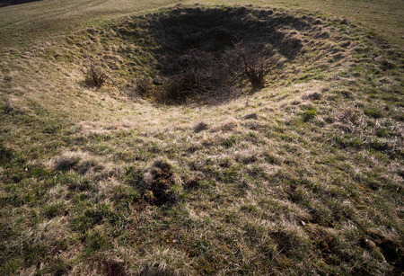 craters: crater on field Stock Photo