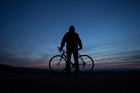 silhouetted cyclist