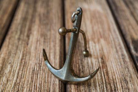 ship anchor: Anchor on a wooden background