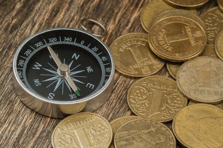 silver coins: Coins on an old wooden background