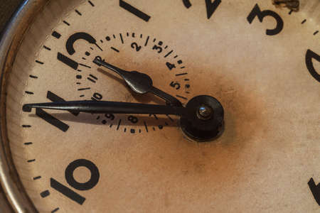 Old alarm clock close-up, time has stopped to ..................