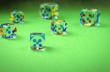 Bones on green cloth  cubes of casino