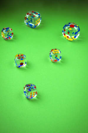 Cubes for dicing on green cloth  cubes dicing on a green background