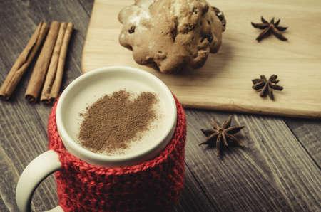 red mug with eggnog with seasonings and cake/red mug with eggnog with seasonings and cake. Top view Stock Photo
