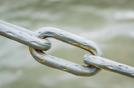 metal chain on water background. Close up