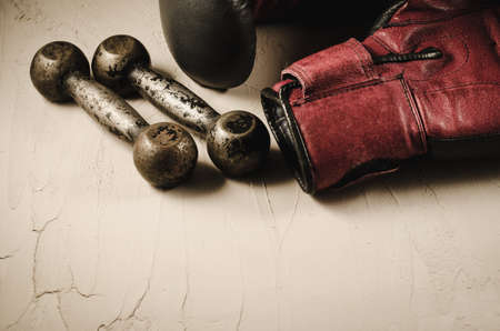 boxing gloves and dumbbells/boxing gloves and dumbbells on a stone background Stock Photo