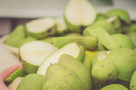 pailful of the ripe cut pearspailful of the ripe cut pears, selective focus