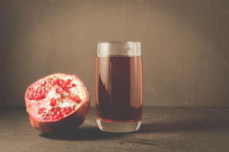 Red pomegranate juice on a dark background