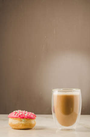 Donut in glaze and a cappuccino Imagens