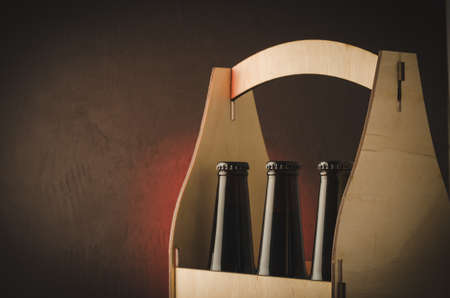 bottles of beer in a wooden case/bottles of beer in a wooden case. Selective focus and copyspace Stock Photo
