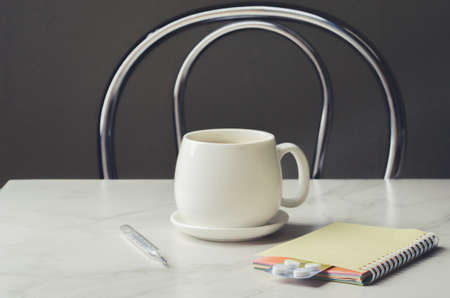 Tea, degrees and tablets/Tea, degrees and tablets on the table.  Foto de archivo