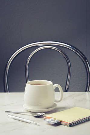 Tea, degrees and tablets/Tea, degrees and tablets on the table. Foto de archivo - 146816672