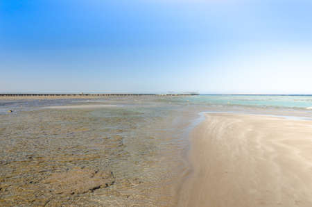 picture of the beautiful view of sea with blue skies/Empty summer beach on the sea and sunny sky