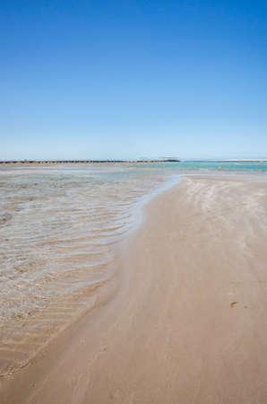 Empty beach on the sea and sunny sky/Empty summer beach on the sea and sunny sky