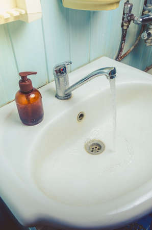 Washbasin with soap accessories/bathroom with washbasin with soap dispenser and cosmetics bottles