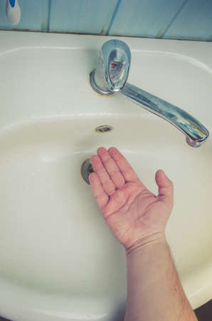 Man washing his Hands to prevent virus infection and clean dirty hands. /Man washes hands with soap Foto de archivo