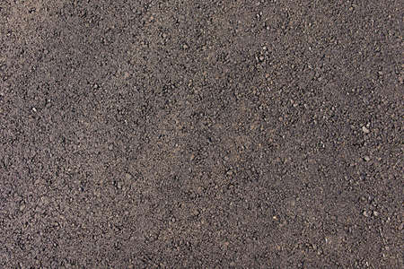 View from above. Background natural gray granite crushed stone, macadam. Macro photo of texture of broken stone or rubble with place for text