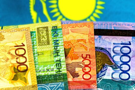 Money Kazakhstan Tenge on the background of the flag Stock Photo