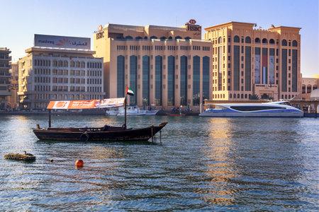 traditional Arabian wooden boat and modern pleasure yacht